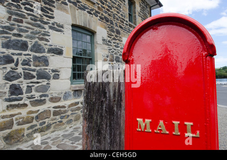 An old red mail box. - Stock Photo