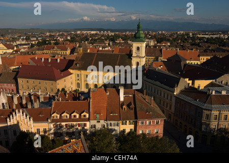 Aerial view over Sibiu city with Fagaras Mountains in the background - Stock Photo