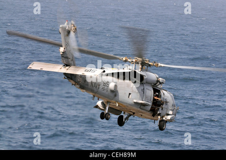 An HH-60H Sea Hawk helicopter assigned to Helicopter Anti-Submarine Squadron 15 launches from the Nimitz-class aircraft - Stock Photo