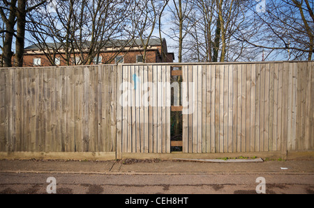 Broken pattern on a wooden fence, Edgware, England, UK. - Stock Photo