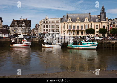 Fishing boats moored on the River Touques at Trouville sur Mer, Normandy, France - Stock Photo