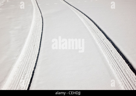 Fresh tire tracks on a snow covered mountain road near Monarch Pass, Chaffee County, Colorado, USA - Stock Photo