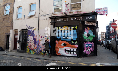 Bistrot Fondue Bar closed shop with grafitti on Chance Street and Redchurch Street Shoreditch Tower Hamlets London - Stock Photo