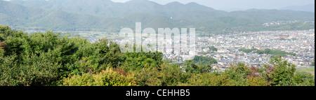 Panorama view of Arashiyama, Kyoto, Japan from a surrounding mountain - Stock Photo