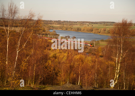 Virgin Trains Pendolino from atop Pooley Hall country park, Polesworth, Warwickshire. - Stock Photo