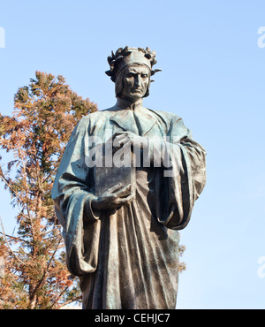 Statue of Dante holding Commedia book in Meridian Hill Park in Washington DC - Stock Photo