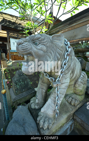 Chained stone statue depicting the tiger - companion to Shiva the Hindu good - Stock Photo