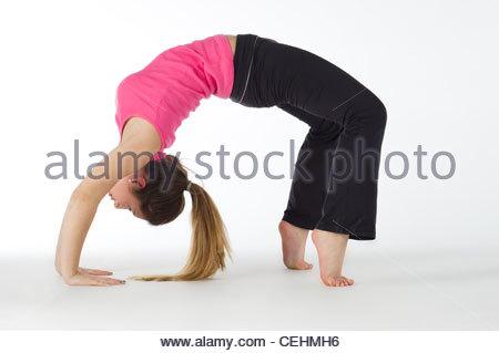 Teen Caucasian girl on a white background doing yoga - Stock Photo