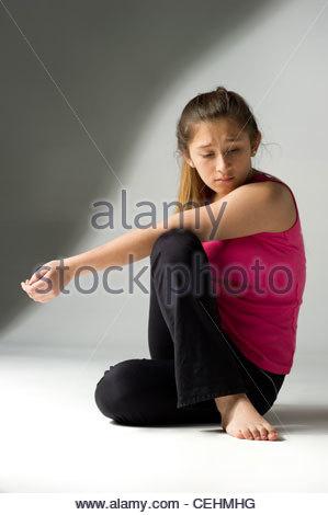 Teen girl on a white background doing yoga - Stock Photo