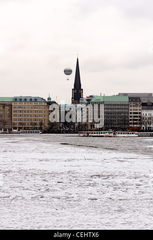 A view of the promenade at the frozen Binnenalster, the smaller of the two lakes in the city center of Hamburg, - Stock Photo