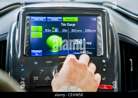 Instrument panel of a Chevrolet Volt plug-in hybrid gas/electric car showing electrical usage and battery charge - Stock Photo