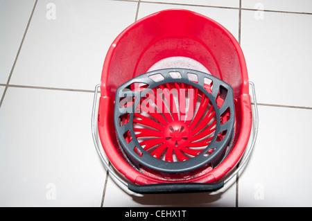 Red Plastic kitchen floor mop bucket top view - Stock Photo