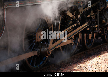 A steam train leaves the station in a cloud of steam on the Jacobite, The train was used for the Harry Potter films - Stock Photo