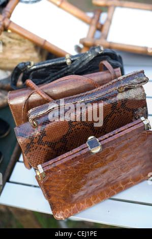 Animal skin handbags, Ardingly Antiques Fair, West Sussex, England, UK - Stock Photo