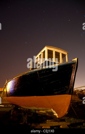 A boat sits in a harbor in the North of England - Stock Photo
