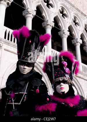 Masked people in Carnival or Carnevale in Venice Italy - Stock Photo