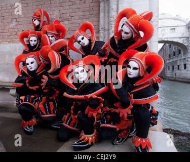 Masked women in Carnival or Carnevale in Venice Italy - Stock Photo