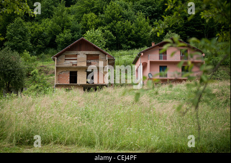 A renewed and destroyed house in village Konjevic Polje in eastern Bosnia and Herzegovina. - Stock Photo