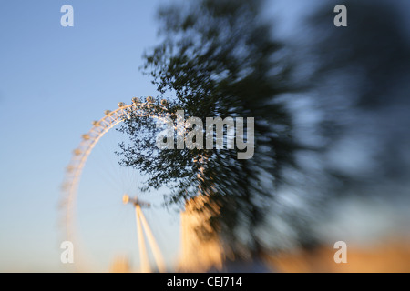 A black and white and colour photograph of the London Eye and Big Ben, there are no people in the shot. - Stock Photo