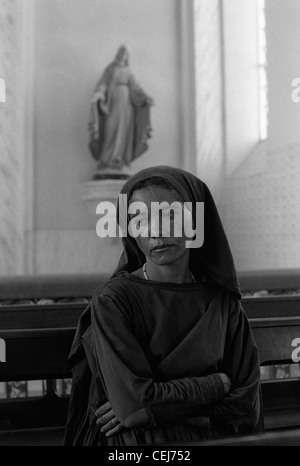 Woman in church, Catholicism. Pilgrimage to Juazeiro do Norte city in Ceara State, Northeastern Brazil - Stock Photo