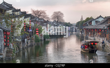 The dusk at the waterway town of Xitang, Jiashan, Zhejiang, China. Traditional houses with red lanterns line the - Stock Photo