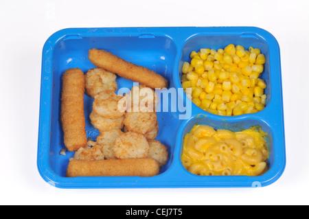 Kid Cuisine Deep Sea Adventure fish stick TV Dinner w/ corn, mac & cheese & hash browns in blue plastic tray by - Stock Photo
