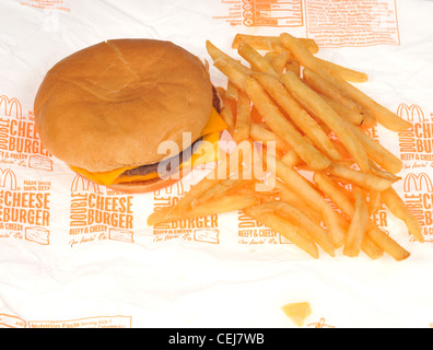 McDonalds double cheeseburger on paper wrapper with french fries or chips on white background USA - Stock Photo