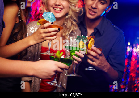Young people spending time in nightclub celebrating an event - Stock Photo