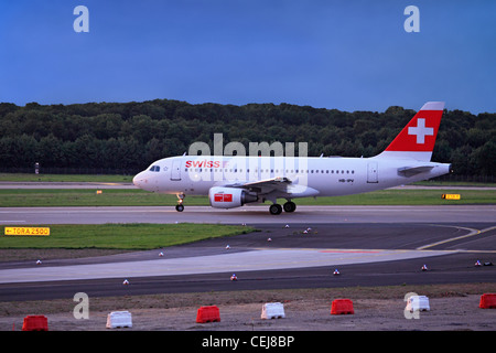 Airliner (Swiss International Airlines) on the runway at Düsseldorf International  Airport, Germany. - Stock Photo