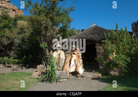 Two men outside traditional hut at Basotho Cultural Village,Qwa Qwa,Eastern Free State Province - Stock Photo