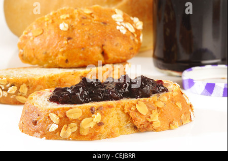 sweet blueberries jam on oat bread - Stock Photo