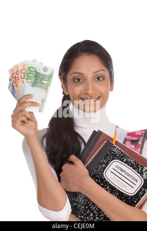 Ethnic Indian college student holds pile 100 (one hundred), 50 (fifty), 20 (twenty) euro bills happy getting scholarship - Stock Photo