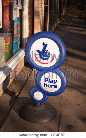 National Lottery sign outside a newsagents shop - Stock Photo