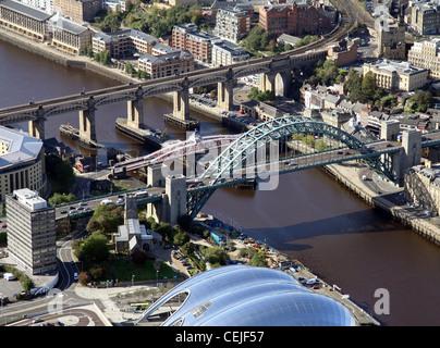 Aerial image of the Tyne Bridge, The High Level Bridge, Swing Bridge, River Tyne and The Sage Gateshead, Newcastle - Stock Photo