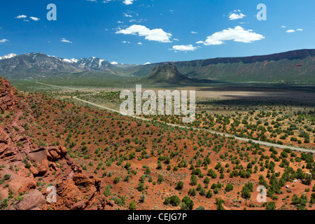 Long empty road travels through the desert canyons of the American Southwest near Arches National Park outside of - Stock Photo