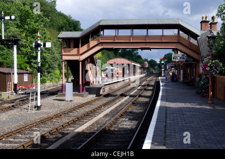 Bewdley Railway Station on the Severn Valley Railway with a footbridge and Class 108 DMU at a siding - Stock Photo