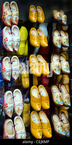 Window display with Dutch wooden shoes in different colors and sizes for sale as a souvenir - Stock Photo