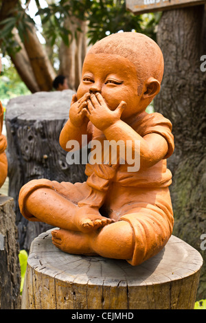 statue of a cute little monk in temple Thailand - Stock Photo