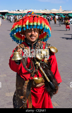 Local man posing for tourists in traditional costume, Djemaa el Fna sqare, Marrakech, Morocco, North Africa - Stock Photo