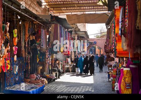 Shops on Rue Riad Zitoun el Kedim off Djema El Fna, Medina, Marrakech, Morocco, North Africa - Stock Photo