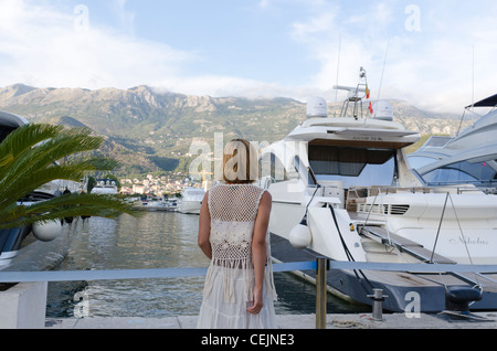 Woman walking at marina in Budva, Montenegro - Stock Photo