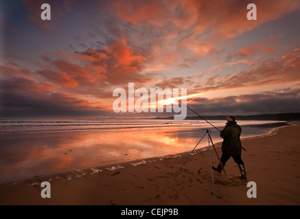 Angler on Newgale Beach, Pembrokeshire - Stock Photo
