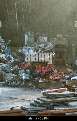A pile of crushed cars in a scrapyard - Stock Photo