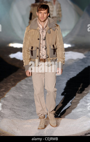 Iceberg Menswear Milan A W Dark blonde male a short khaki motorcycle jacket over a puffy vest, khaki trousers and - Stock Photo