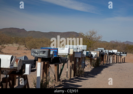 Three Pointes, Arizona - A long row of mailboxes are lined up along a dirt road in the desert west of Tucson. - Stock Photo
