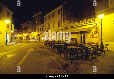 Empty street café at night in Rovinj, Istria, Croatia - Stock Photo