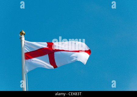 The flag of St George flying on St George's Day. - Stock Photo