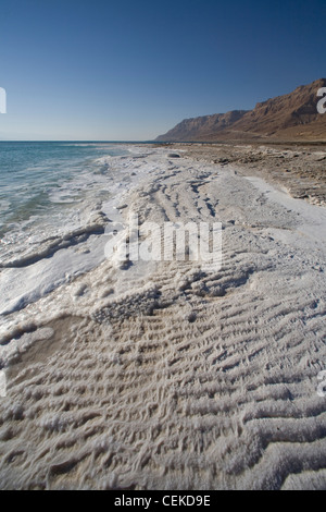 Dead Sea landlocked salt lake in Jordan Rift Valley on border between Israel Jordan 422 meters below sea level lowest - Stock Photo