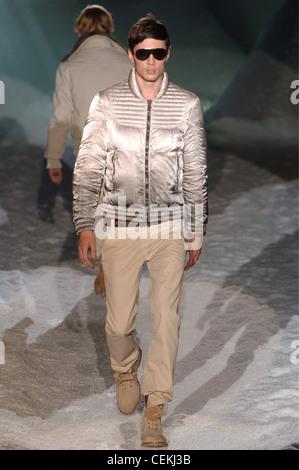 Iceberg Menswear Milan A W Brunette male wearing a taupe puffy satin motorcycle jacket khaki trousers, matching - Stock Photo