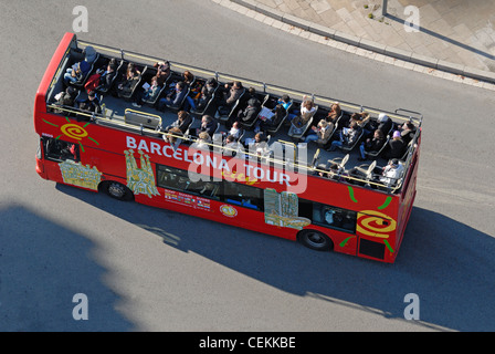Barcelona, Spain. Open-topped tourist bus seen from the top of the Monument a Colom / Monument to Columbus - Stock Photo